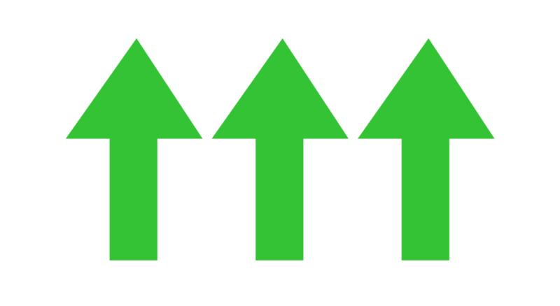 Upwards pointing green arrows